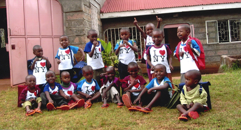 Kenyan Group - children sitting and standing in a group photo.